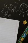 Тетрадь в линейку с косыми линиями с нанесением текста В школу