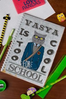 Блокнот в клетку с Вашим текстом «Too cool for school»
