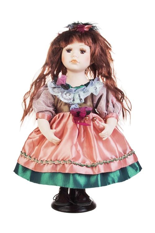 Кукла Кареглазая малышкаФарфоровые куклы<br>Выс=31см, фарфор, текстиль, в розово-изумрудном платье, на подставке<br>