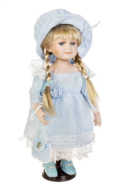 Кукла Небесная малышкаИгрушки и куклы<br>Выс=35см, фарфор, текстиль, в голубом платье, с сумочкой, на подставке<br>