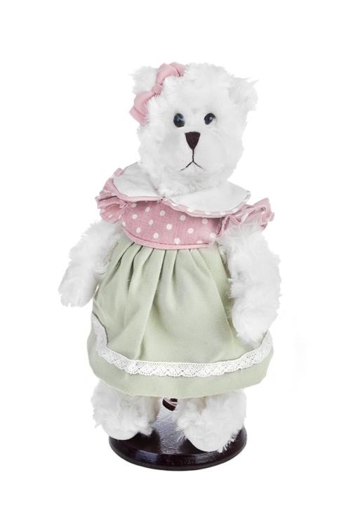 Игрушка мягконабивная Мишка в летнем платьеИгрушки-куклы<br>Выс=28см, текстиль, бело-зелено-розов., на подставке<br>