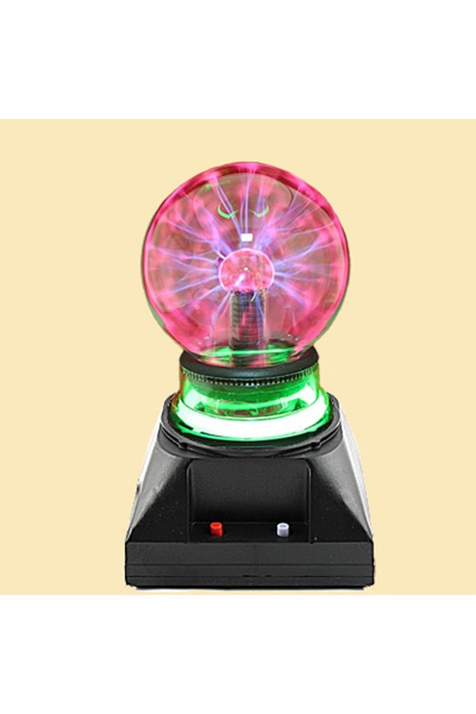 Светильник ПлазмаИнтерьер<br>Плазменный светильник в виде шара на подставке, при включении создаёт внутри стеклянной сферы множетсво цветных молний, разбегающихся во все стороны из центра. Если поднести к поверхности шара палец, молнии сольются в один мощный поток. На подставке имеется кнопка подзвучки. Светильник работает от сети 220V, требует осторожного обращения, использования строго в соответствии с инструкцией. Обращаем Ваше внимание, что воизбежание перегрева и для сохранения рабочих свойств светильника, рекомендуется его выключение после каждых двух-трёх часов непрерывной работы. Размер светильника: 19х11х11 см. Диаметр лампы 9 см. материал: стекло, пластик<br>