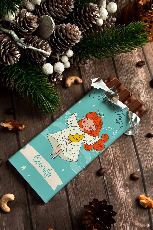 Шоколад с Вашим именем АнгелПодарки для малышей и новорожденных<br>Молочный шоколад с изюмом и орехами в персональной именной упаковке будет приятным сувениром для сладкоежки! Масса - 90г.<br>