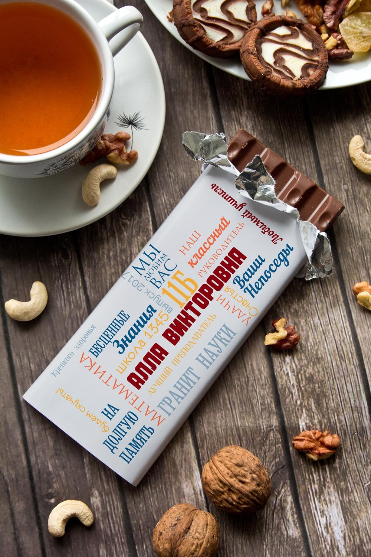 Шоколад с Вашим именем Слова учителюПодарки к окончанию школы<br>Молочный шоколад с изюмом и орехами в персональной именной упаковке будет приятным сувениром для сладкоежки! Масса - 90г.<br>